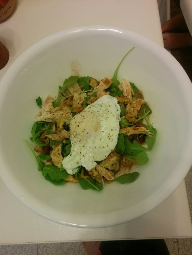 """Breakfast """"hash"""" with sweet potato, arugula, roast chicken, walnuts, cinnamon, olive oil, salt, and pepper topped with a poached egg."""