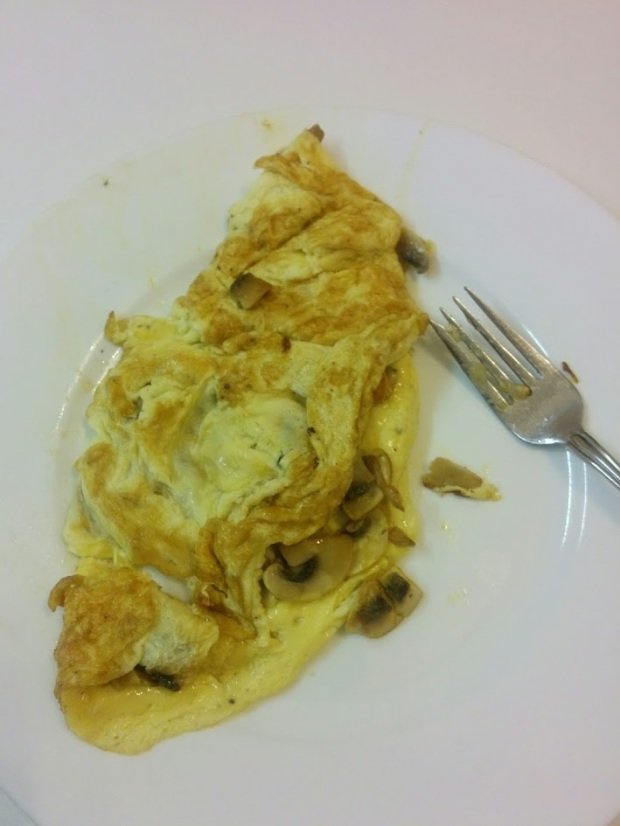 Mushroom omelette eaten with a couple bites of pear